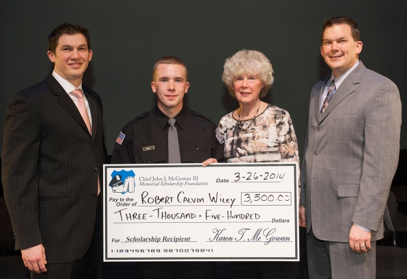 Police 2: Karen McGowan and her sons Scott McGowan and John McGowan IV present the Chief John J. McGowan III Memorial Scholarship to Robert Calvin Wiley, Willow Grove.  Photos by John Welsh