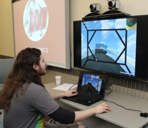 CIS Tech 2: Student Zac Chelbi demonstrates a level on The Big Robot Game, which his team developed as part of MCCC's Electronic Game and Simulation Design program.