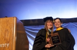 Grad 3: Vice President for Academic Affairs & Provost Dr. Vicki Bastecki-Perez presents Jill Beccaris-Pescatore, Glenside, Assistant Professor of Economics, with the Pearlstine Award for Teaching Excellence. Photo by John Welsh