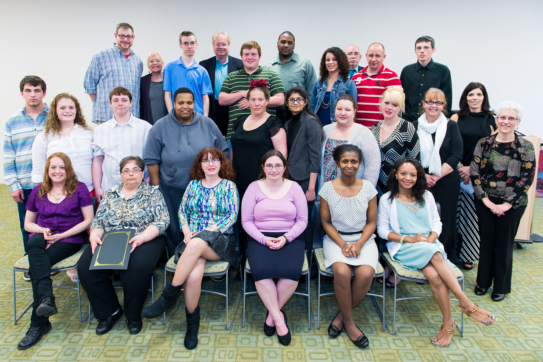 POWER and POWER Plus Program participants and staff at April 2014  graduation ceremony. Photo by