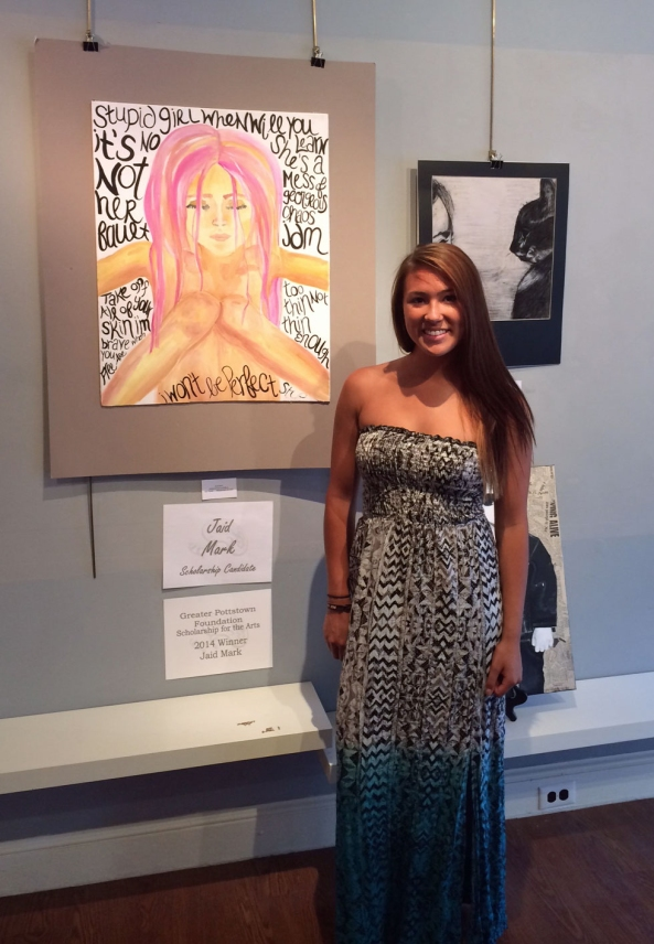 "Scholarship winner Jaid Mark with ""Her Flaws"" watercolor and acrylic in background"