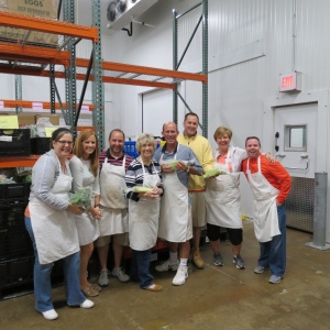 Shown left to right at the Food Bank warehouse are: Gail Coxe; Kelly Hoover; Phil Gagliardi; Carol Olver; Pete Hoover; Jerry Fahey; Beth Hoover; and Tim Curvan.