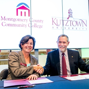 PHOTO: Montgomery County Community College President Dr. Karen A. Stout and Kutztown University Acting President Dr. Carlos Vargas-Aburto sign the first reverse transfer agreement between a community college and State System institution in Pennsylvania. Photo by Sandi Yanisko