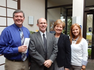 Larry Welsch, Chester County Food Bank executive director, is all smiles as he accepts a check from Hoover Financial Advisors. Shown with Welsch (l to r) are Pete Hoover, Beth Hoover and Kelly Hoover.