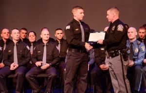 Photos by Matt Carlin Police 1: Cadet Lt. Brian Manion (right), Conshohocken, presents Class 1404 Valedictorian James Reilly, Chalfont, with a certificate for his academic accomplishments.