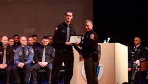Photos by Matt Carlin Police 2: Cadet Tori Adams (left), Langhorne, receives the James R. Miller Marksmanship Award from Cadet Lt. Brian Manion.