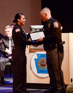 Photos by Matt Carlin Police 3: Cadet Lt. Brian Manion (right) presents Cadet Cpl. Amal Yasin, Philadelphia, with the Award of Distinction, given to a cadet who demonstrates exemplary dedication and teamwork.