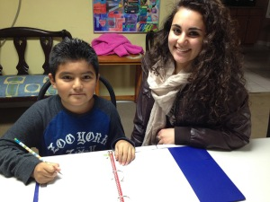 CCATE 1: Montgomery County Community College Honors Program student Sussan Saikali works on homework with Kevin, a participants in the Center for Culture, Art, Training, and Education's (CCATE) after school program.
