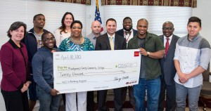 Photo: Wells Fargo recently presented a $20,000 grant to Montgomery County Community College to provide scholarships for students participating in the College's Minority Student Mentoring Initiative. Back row, from left:  Student Zachary Collier, Philadelphia; Tara A. Brady, Wells Fargo Assistant Vice President/Senior Relationship Manager; student Fernando Garcia, Pottstown; Edward Brown, MCCC Academic Advisor; and Dr. Steady Moono, Vice President of West Campus in Pottstown. Front row, from left: Dr. Karen A. Stout, College President; student Jacori McEachnie, Eagleville; student Diahann McIntyre, Norristown; Anthony Rosado, Wells Fargo Area President for Montgomery County; student Clifton Ford, Pottstown; and Wilson Gonzalez, Souderton. Photo by Sandi Yanisko.