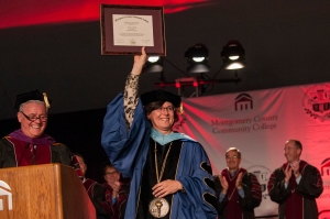 Honorary Degree: Board of Trustees Chairman Michael D'Aniello presents Dr. Karen A. Stout with an honorary associate's degree in letters during Montgomery County Community College's 48th Commencement ceremony on May 21, 2015. Photo by John Welsh