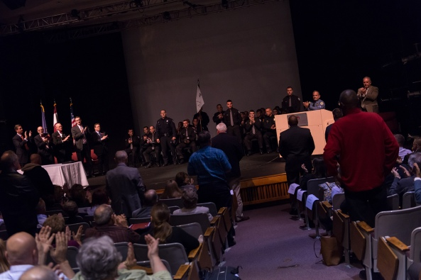 During his keynote address, Lower Moreland Township Police Sgt. David Scirrotto asked all veterans on stage and in the audience to stand and be recognized for their service in honor of Veterans Day.   Photos by Sandi Yanisko