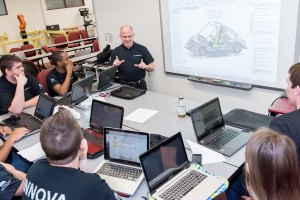 PHOTO: Members of MC3 Engineering INNOVA discuss design modifications to their urban concept vehicle. Students are raising money via Go Fund Me to purchase materials to complete their vehicle and to compete in the Shell Eco-marathon Americas 2016 in Detroit, Mich. this spring. Photo by Sandi Yanisko