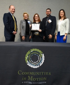 PHOTO: Communities in Motion CEO Rob Henry (far left) and COO Maureen Farrell (far right) present members of Montgomery County Community College's Climate Commitment Advisory Council with a 2015 Star Award. Accepting the award on behalf of MCCC are (from left) Peggy Lee-Clark, executive director of government relations and special, projects; Alana Mauger, director of communications; and Joshua Eckenrode, instructional designer. Photo courtesy of Communities in Motion.